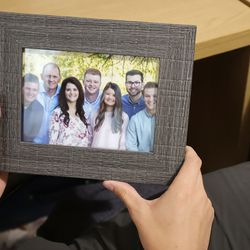 Elder Cole Draper, a missionary for The Church of Jesus Christ of Latter-day Saints, looks at a photo of his family in his and his companion's apartment in Bologna, Italy, on Thursday, Sept. 16, 2021.