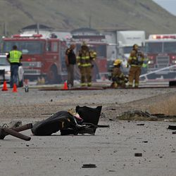 Firefighters douse flames from a crash on I-80 Saturday near the Salt Lake-Tooele border. A westbound FedEx semitruck collided with a Dodge Dakota, killing the driver of the Dodge and injuring the FedEx driver. Traffic on I-80 was shut down for about four hours.