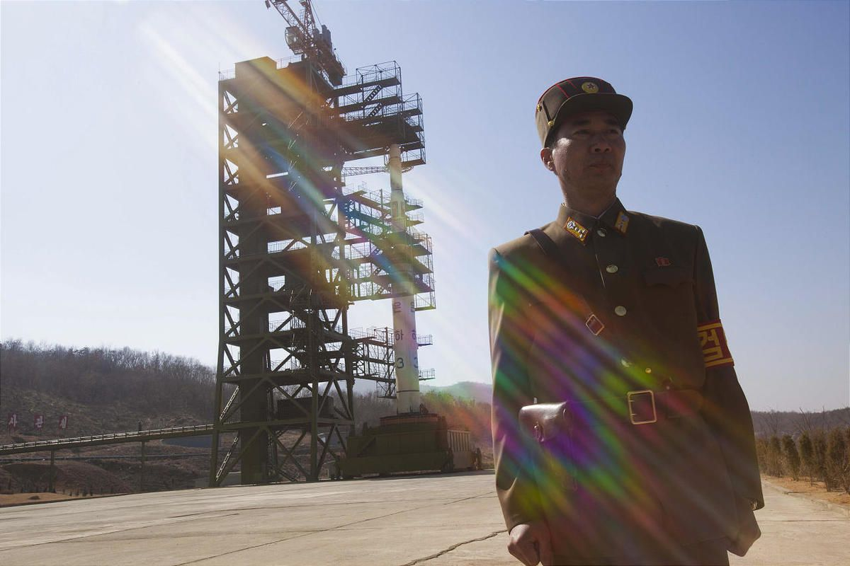 A North Korean soldier stands in front of the country's Unha-3 rocket, slated for liftoff between April 12-16, at Sohae Satellite Station in Tongchang-ri, North Korea on Sunday April 8, 2012. North Korean space officials have moved a long-range rocket int