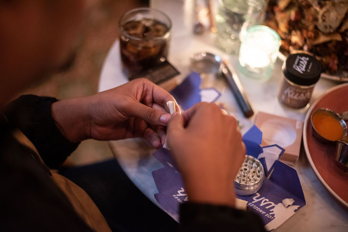 A Lowell Cafe customer rolling a joint at the U.S.'s first cannabis restaurant