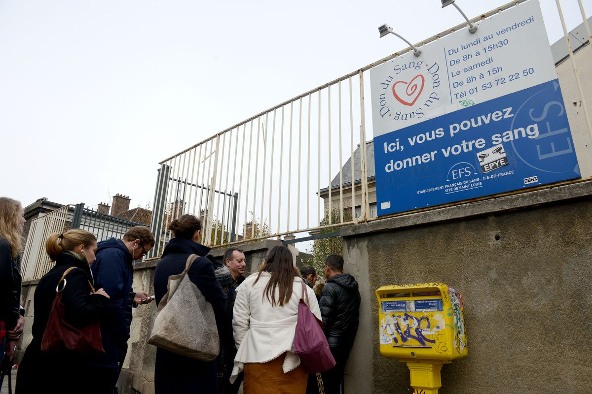 People line up to give their blood near the Carillon bar, the day after a deadly attack on November 14, 2015, in Paris, France.