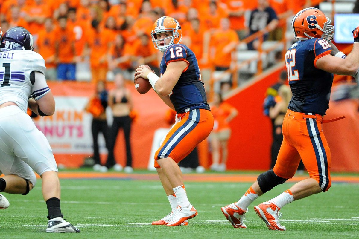 Sep 1, 2012; Syracuse, NY, USA; Syracuse Orange quarterback Ryan Nassib (12) scans the field during the third quarter against the Northwestern Wildcats at the Carrier Dome. Mandatory Credit: Rich Barnes-US PRESSWIRE