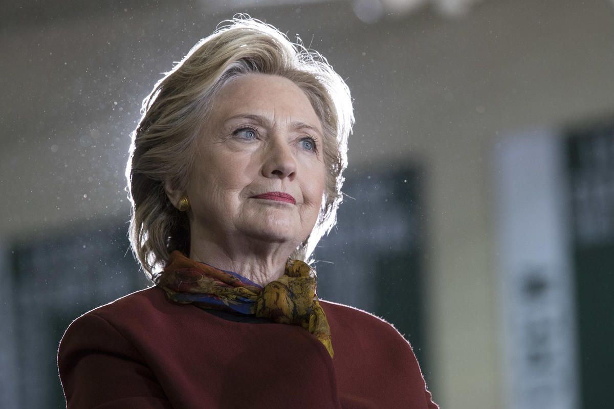Democratic presidential candidate Hillary Clinton listens as vice presidential candidate Sen. Tim Kaine, D-Va. speaks during a campaign event at the Taylor Allderdice High School, Saturday, Oct. 22, 2016, in Pittsburgh, Pa.