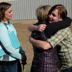 Abby Petchinsky, 21, of Mt. Pleasant, right, hugs Jolene Green, LCSW, while Brittani Frade, CMHCi, left, looks on at The Barn in South Jordan on Friday, March 17, 2017.