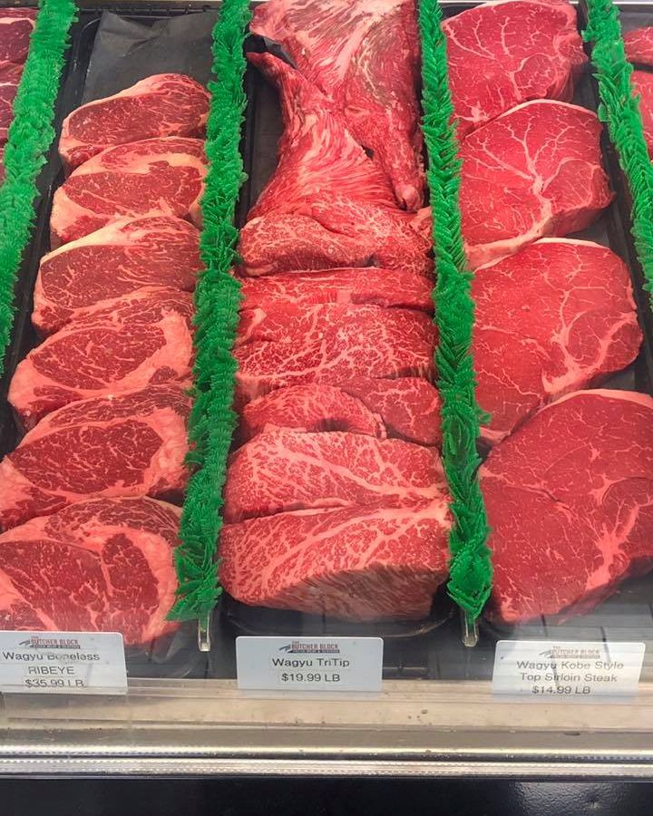 Three cuts of beef in a cooler
