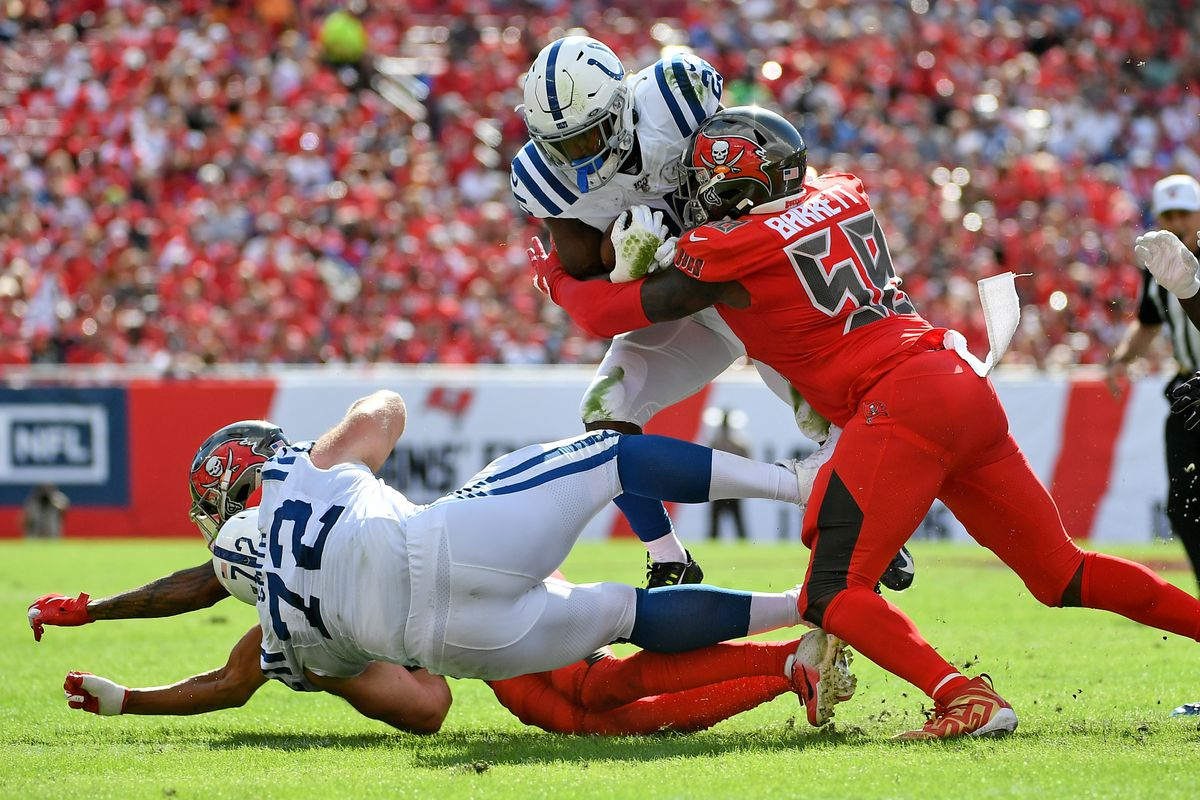 Tampa Bay Buccaneers linebacker Shaquil Barrett tackles Indianapolis Colts running back Marlon Mack during the first half at Raymond James Stadium.