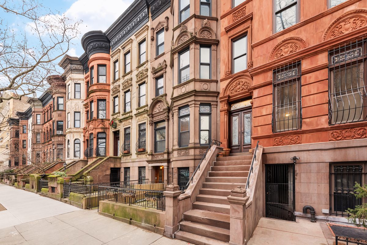 An ornate red brownstone facade.