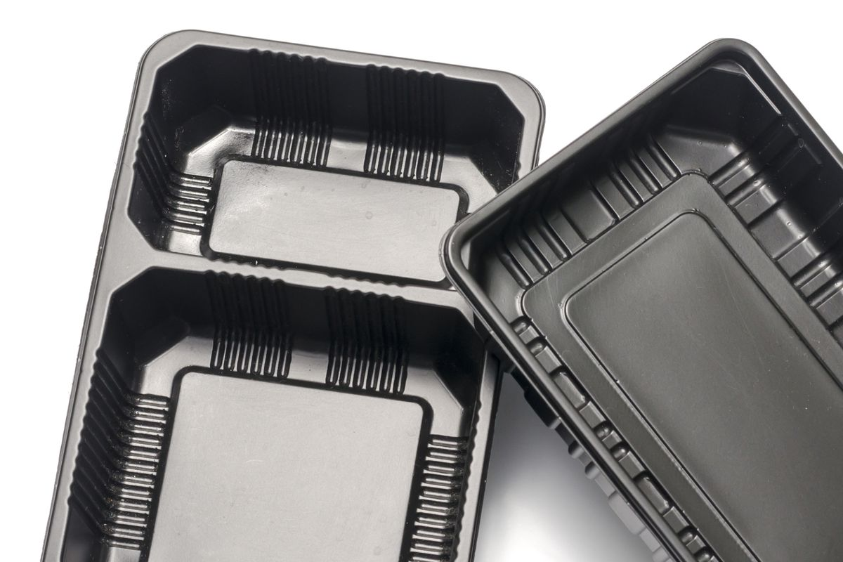 Two black plastic takeout containers.