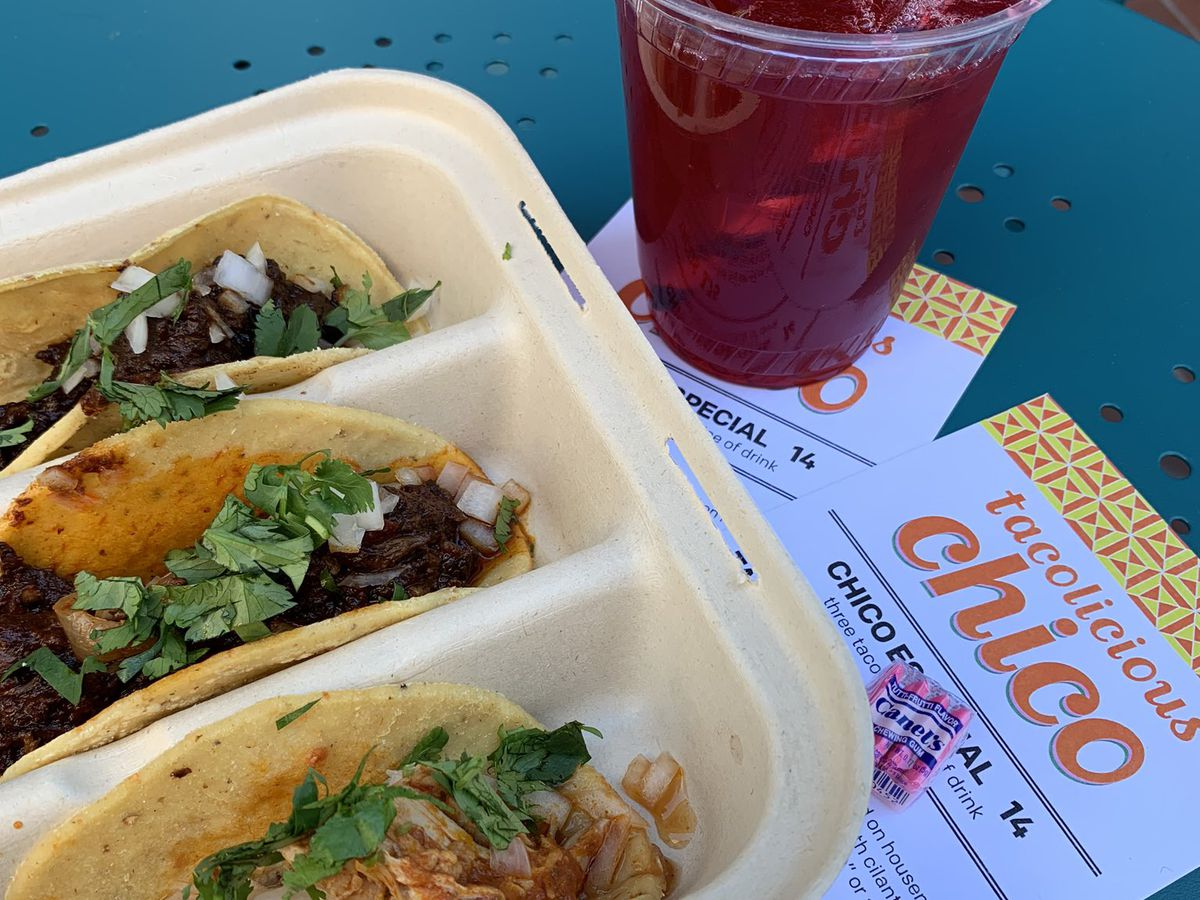 To-go container of tacos with side of spicy beverage