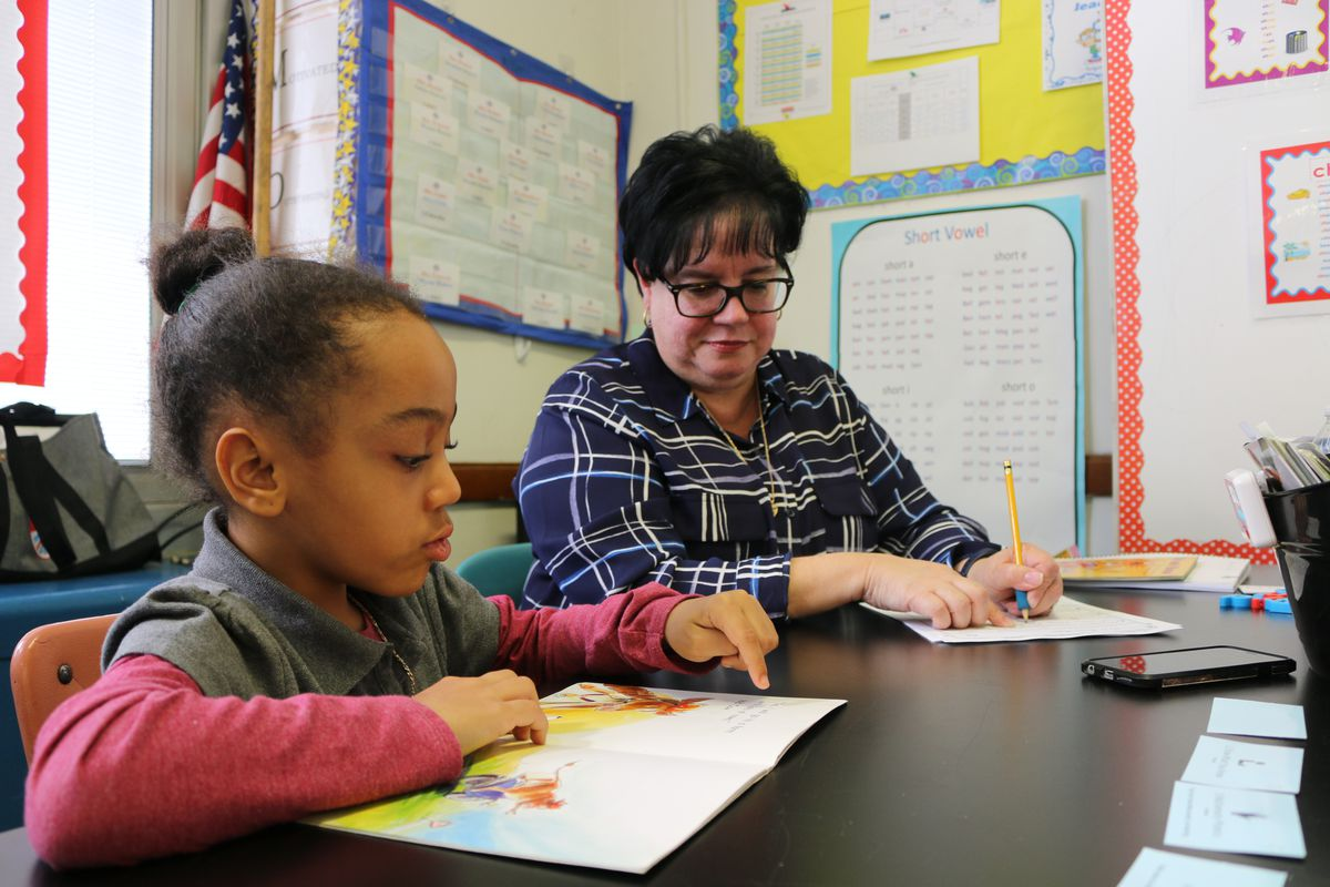 Eileen Bramer (right) conducts a reading intervention with Peyton, a first grader at P.S. 111 in Queens.