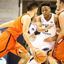 Brigham Young Cougars guard Jahshire Hardnett (0) gets caught in the screen by Idaho State Bengals forward Blake Truman (24) as Idaho State Bengals guard Geno Luzcando (1) dribbles past as BYU takes on Idaho State at the Marriott Center in Provo on Thursday, Dec. 21, 2017.
