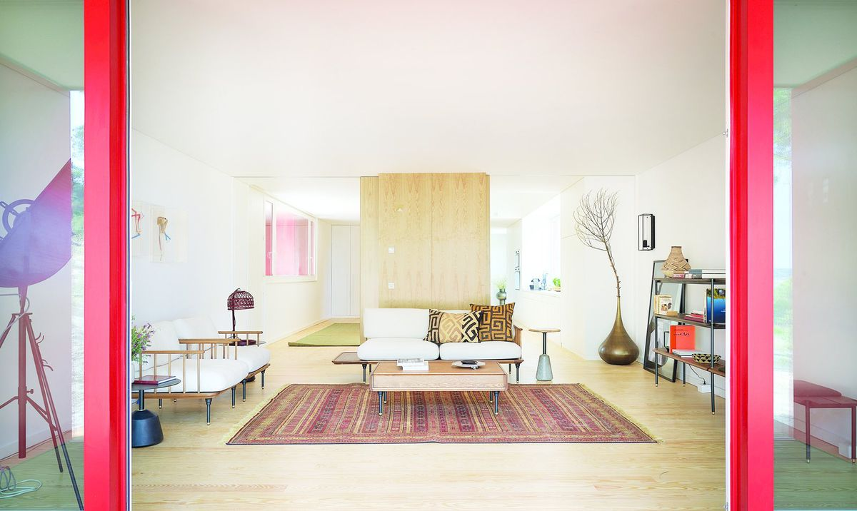 Living room with pale wood floors and white walls