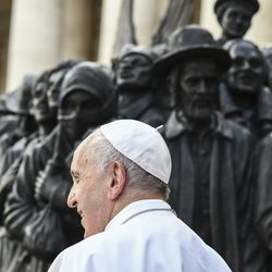 """Pope Francis unveils the sculpture on the theme of refugees and migration, """"Angels Unawares,"""" by Canadian sculptor Timothy P. Schmalz, on the occasion of the Migrant and Refugee World Day, in St. Peter's Square, at the Vatican, Sunday, Sept. 29, 2019."""