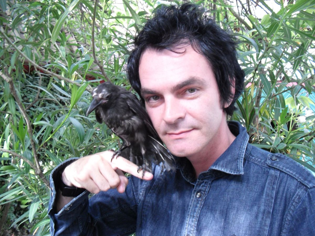 Joe Cassidy and a wild crow that came to rest on him.