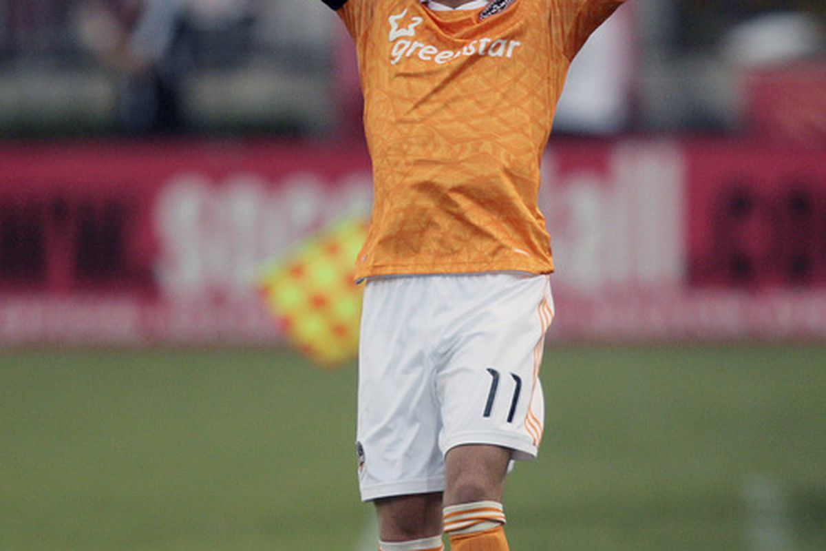 Brad Davis and the Houston Dynamo face the LA Galaxy later today. After that match, the playoff picture will be set. (Photo by Bob Levey/Getty Images)