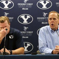 Bronco Mendenhall gets emotional as athletic director Tom Holmoe talks about Mendenhall leaving BYU to take over for Mike London at Virginia after 11 years as BYU's head football coach during a press conference at BYU in Provo on Friday, Dec. 4, 2015.