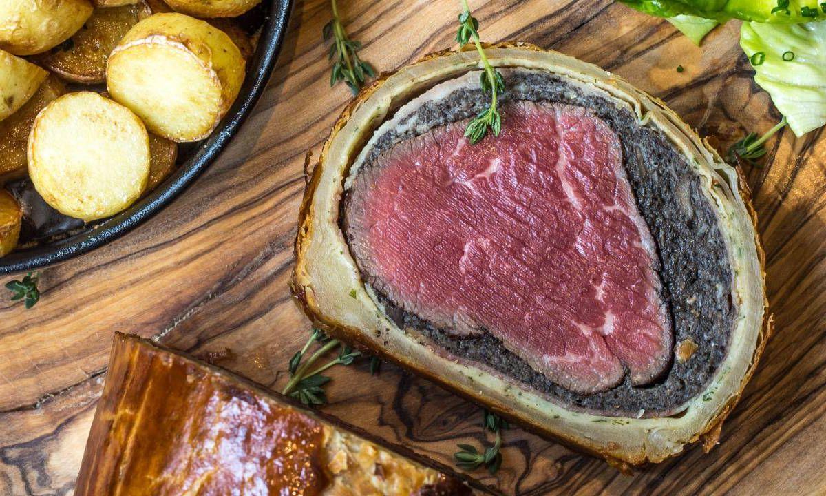 Beef Wellington on a wooden cutting board