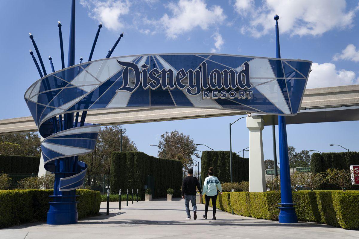 Two visitors enter Disneyland Resort in Anaheim, California.