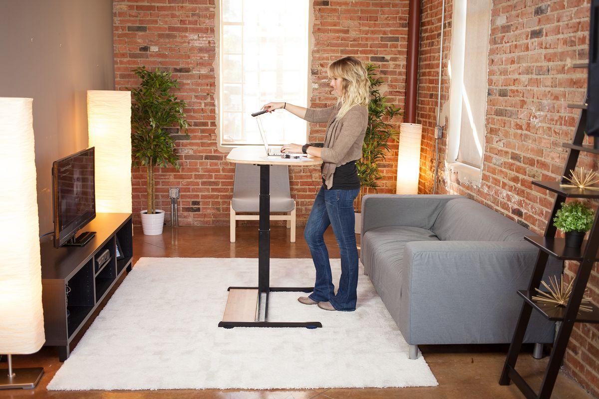 Living room setup showing a standing desk.