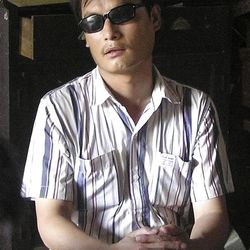 Chen Guangcheng, a leading figure in China's rights movement, sits in a village in China.