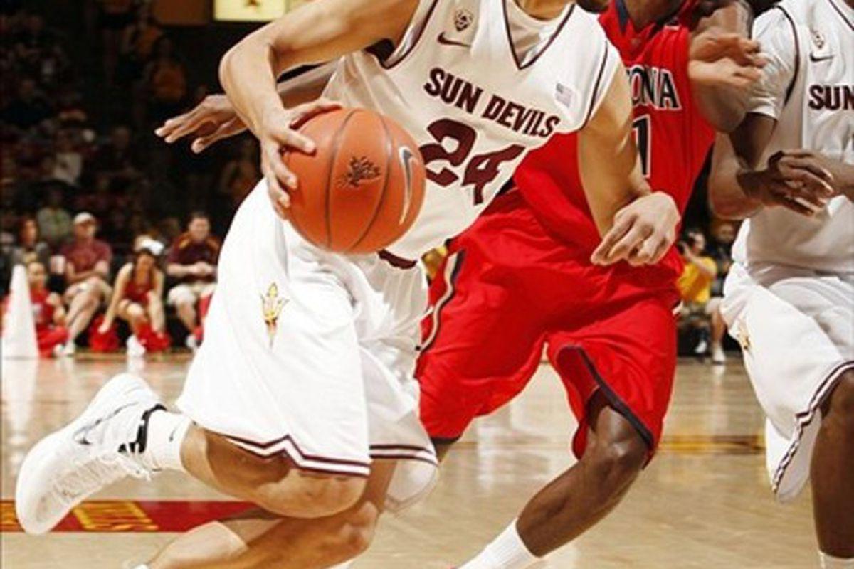 March 4, 2012; Tempe, AZ, USA; Arizona State Sun Devils guard Trent Lockett (24) drives on Arizona Wildcats guard Josiah Turner (11) in the first half at Wells Fargo.