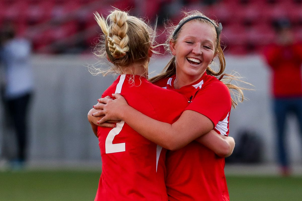 American Fork's Nicole Lewis, left, and Ruby Hladek hug after Lewis scored on a penalty kick, putting their team up 2-0 over Fremont, in a 6A girls soccer semifinal game at Rio Tinto Stadium in Sandy on Tuesday, Oct. 20, 2020.