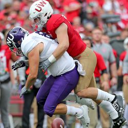 Jack Sanborn led the team with 13 tackles.Here he drops into coverage and breaks up the NU attempt.