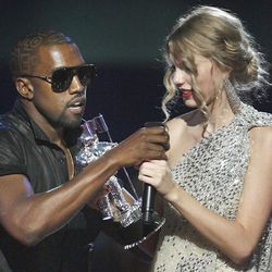 """In this Sept. 13, 2009, file photo, singer Kanye West takes the microphone from singer Taylor Swift as she accepts the """"Best Female Video"""" award during the MTV Video Music Awards in New York."""
