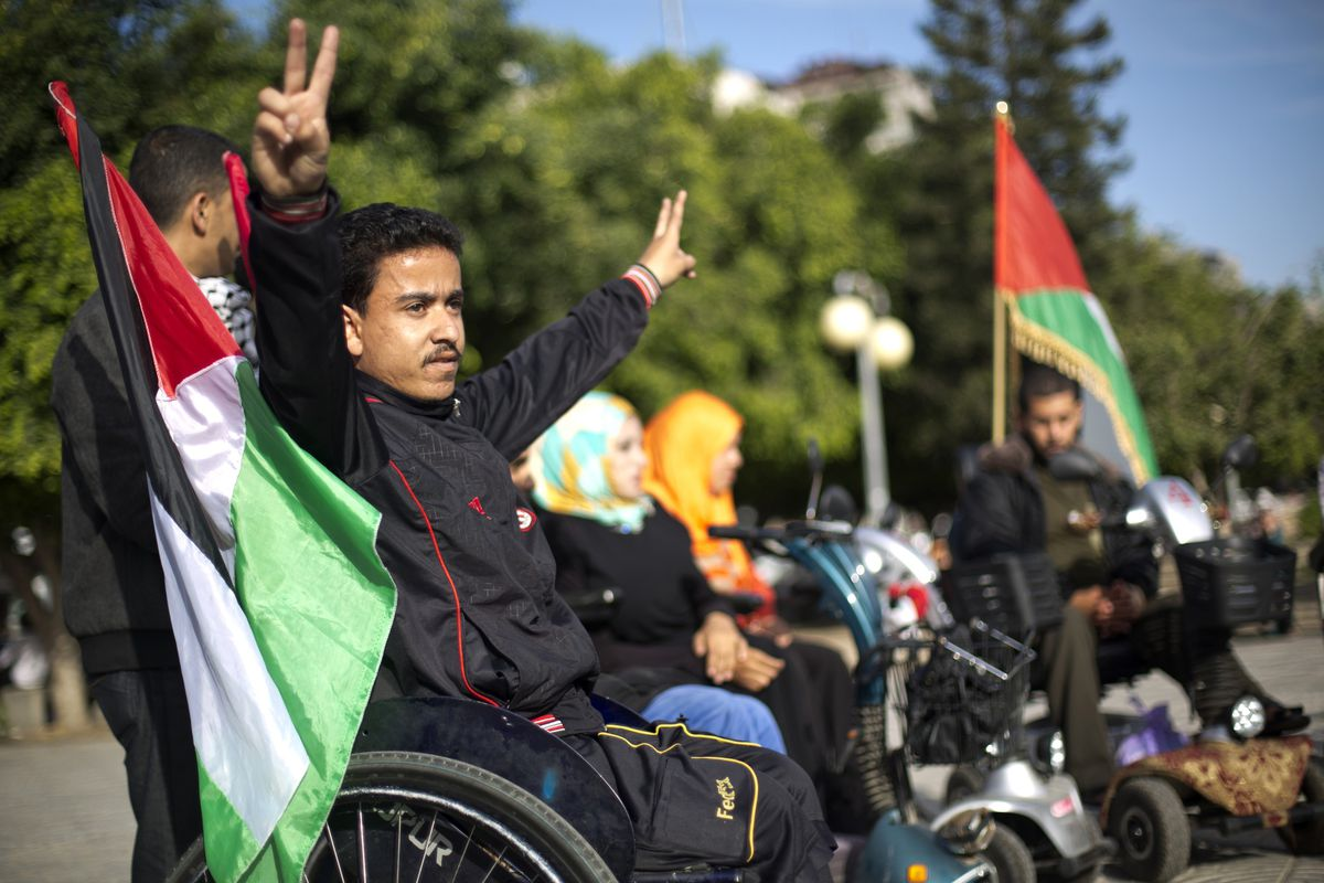 Palestinians with special needs celebrate the unity deal