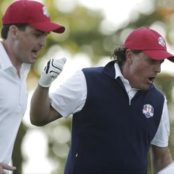 USA's Keegan Bradley, left, and Phil Mickelson react on the 17th hole during a four-ball match at the Ryder Cup PGA golf tournament Friday, Sept. 28, 2012, at the Medinah Country Club in Medinah, Ill. (AP Photo/Charlie Riedel)