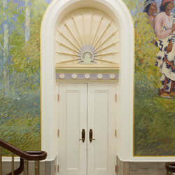 A detailed arched door casing in the upper grand hall of the Mesa Arizona Temple shows off the Colonial Revival style, popular in 1920s America, that includes fluting, rosettes, and egg and dart motifs.