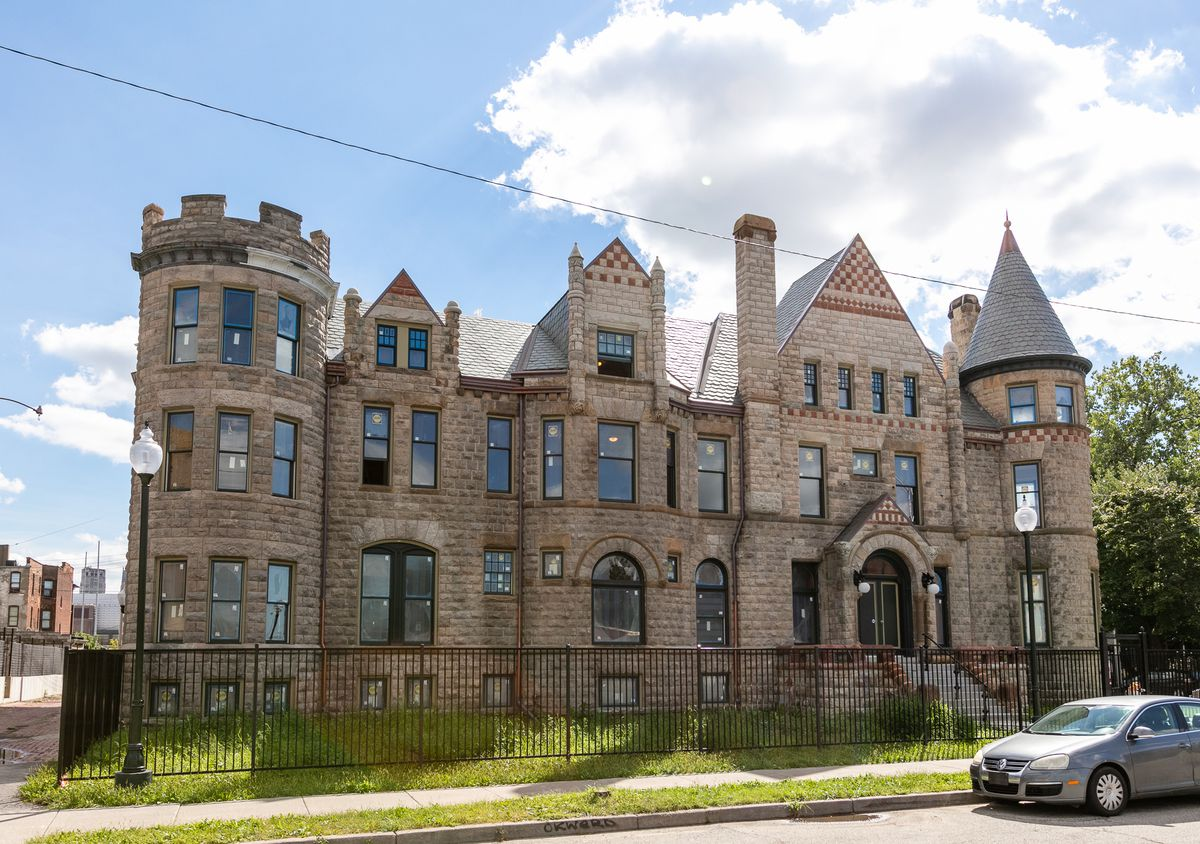 The exterior of the James Scott mansion in Detroit.  The facade is made of brown brick with several towers and spiers.