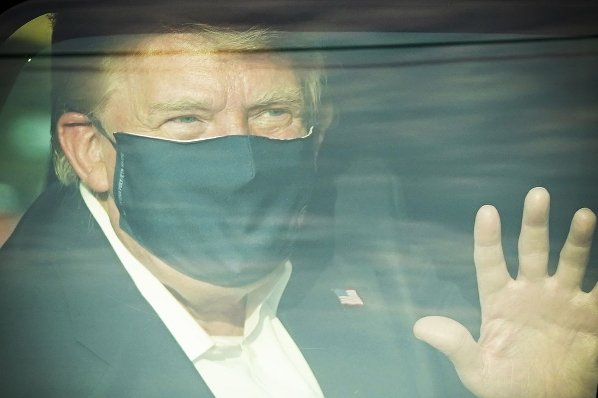 President Trump wearing a face mask inside his presidential limo.