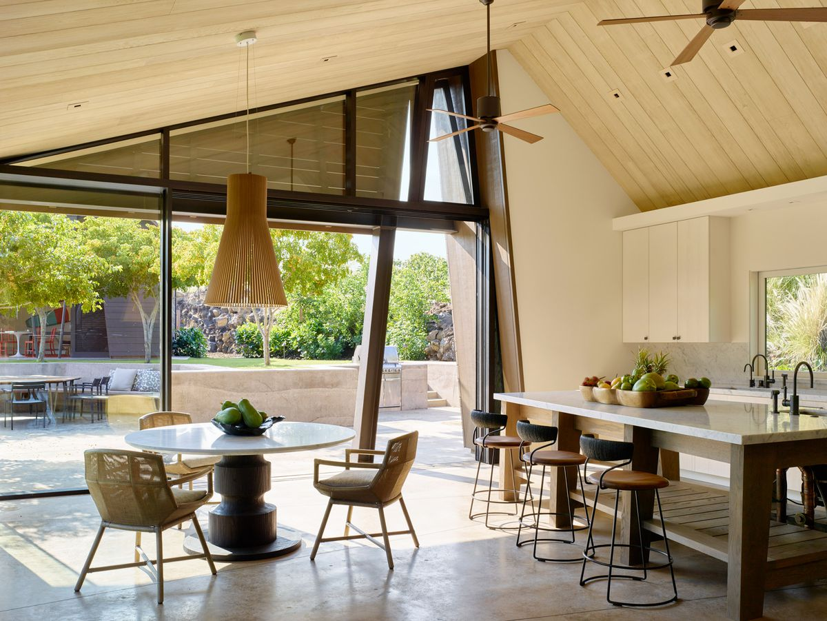 Airy kitchen with polished concrete floors and large windows