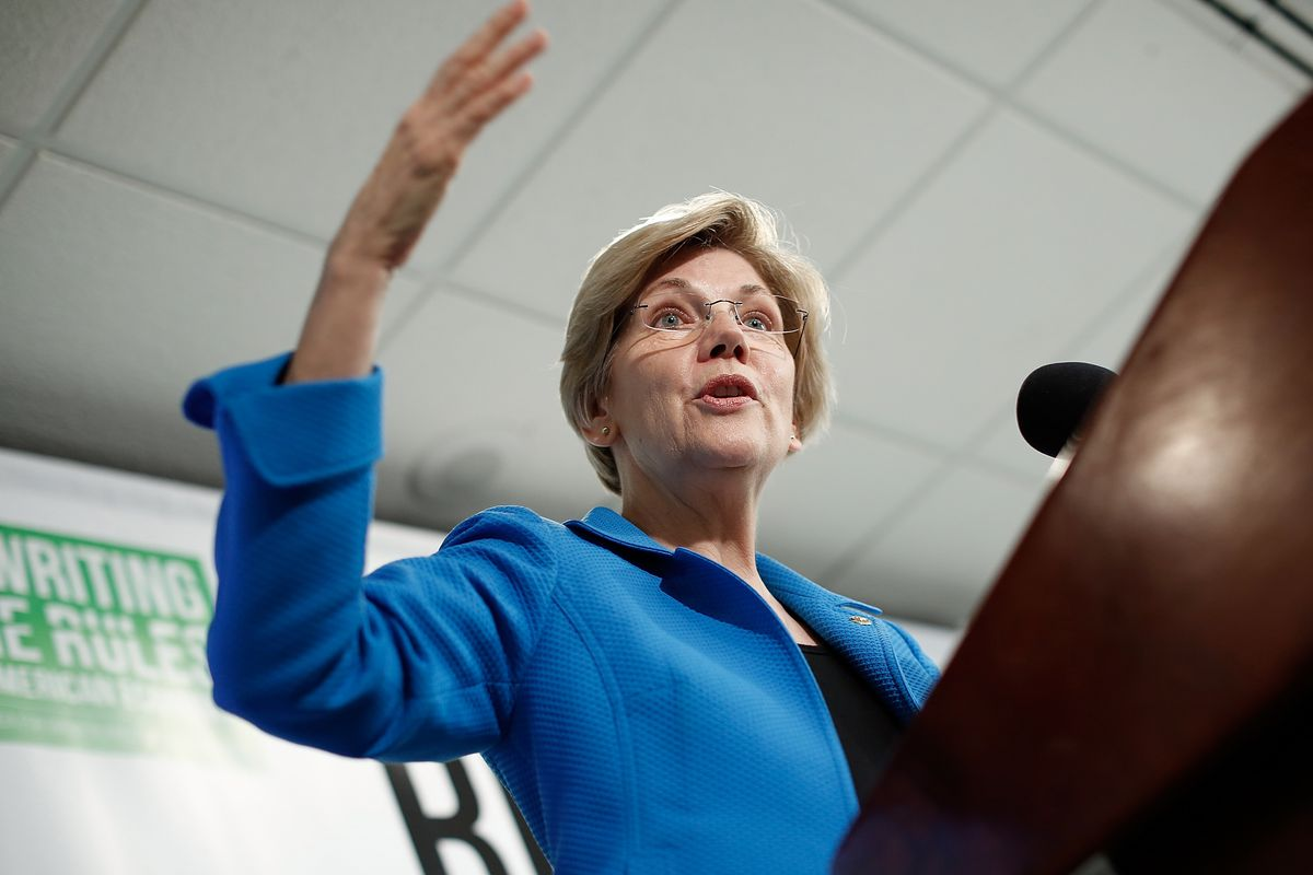 Sen. Elizabeth Warren (D-MA) speaks about the release of a new report authored by Nobel-prize winning economist Joseph Stiglitz published by the Roosevelt Institute May 12, 2015 in Washington, DC..