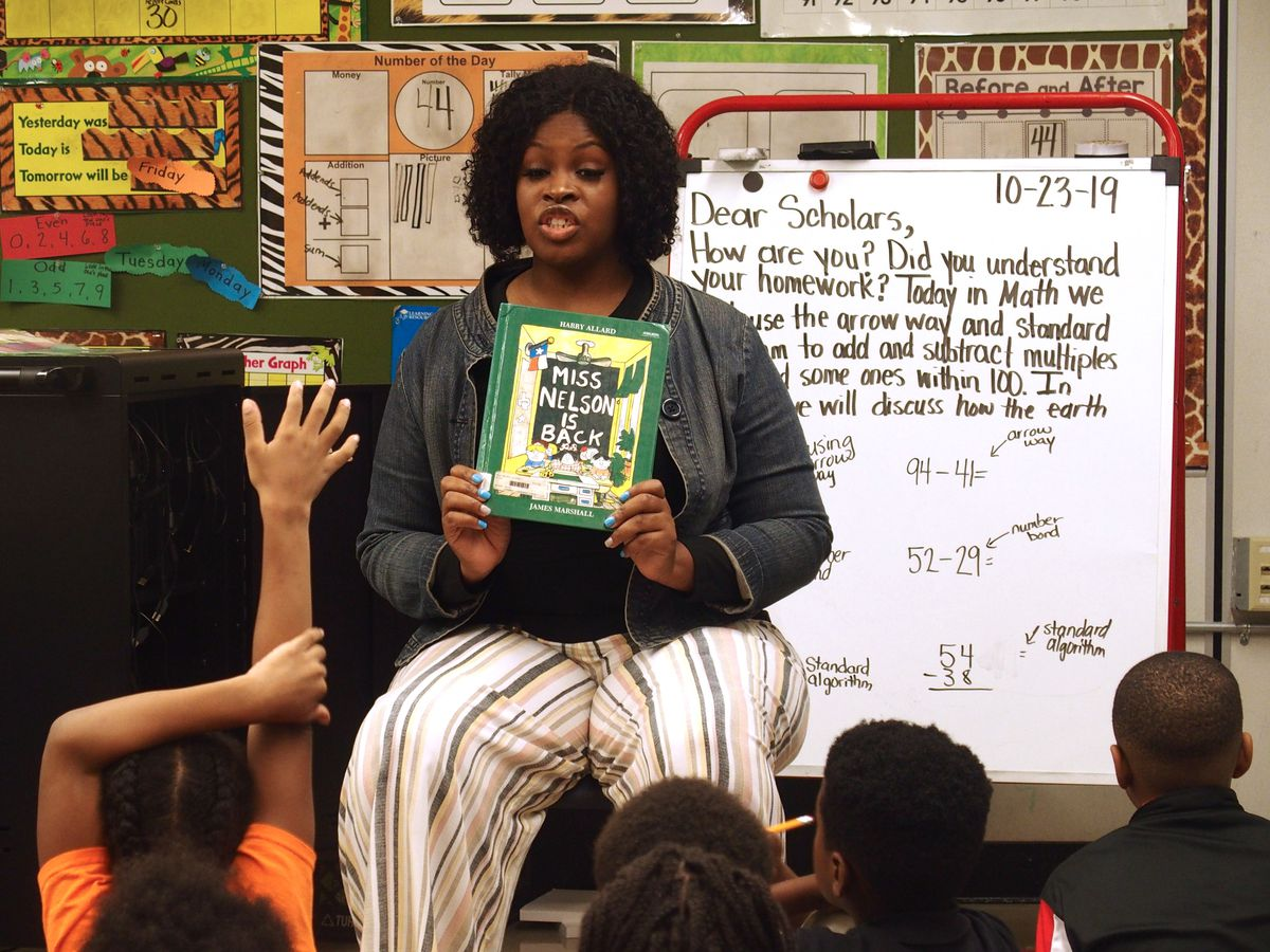 School board member Stephanie Love reads to students at Newberry Elementary School. She has led the board's charge to the district's administration to effectively communicate the new retention policy to parents.