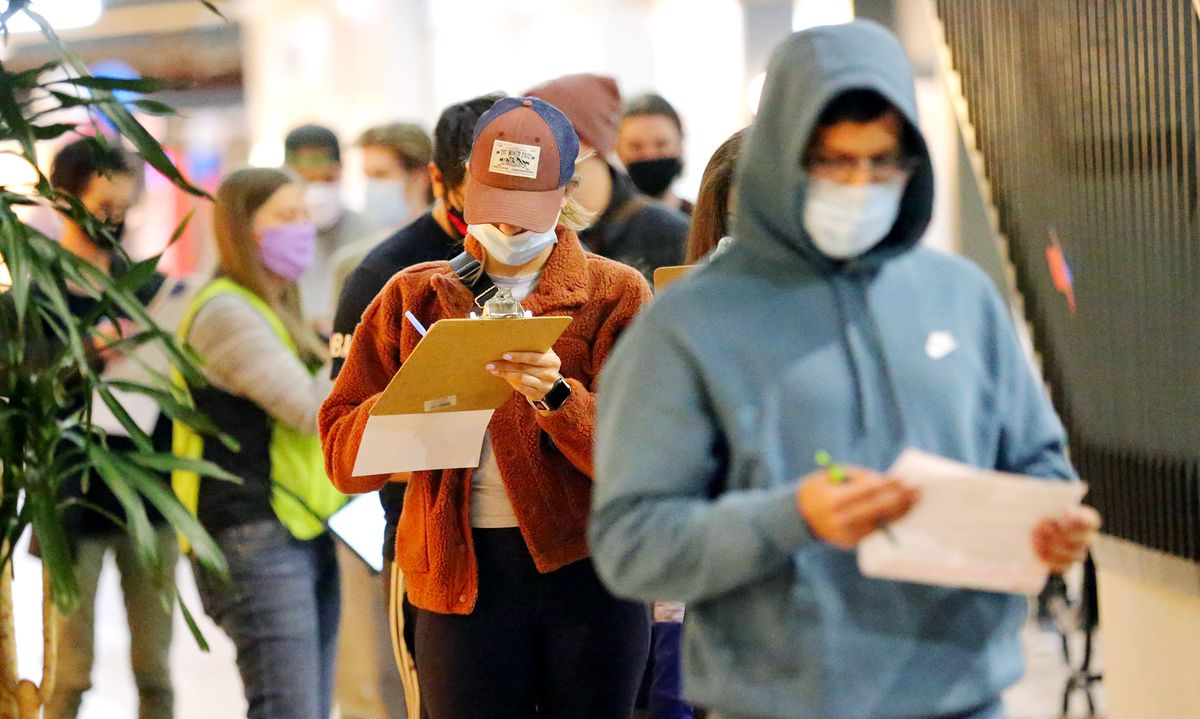 Voters line up to cast their ballots at Trolley Square in Salt Lake City on Tuesday, Nov. 3, 2020.