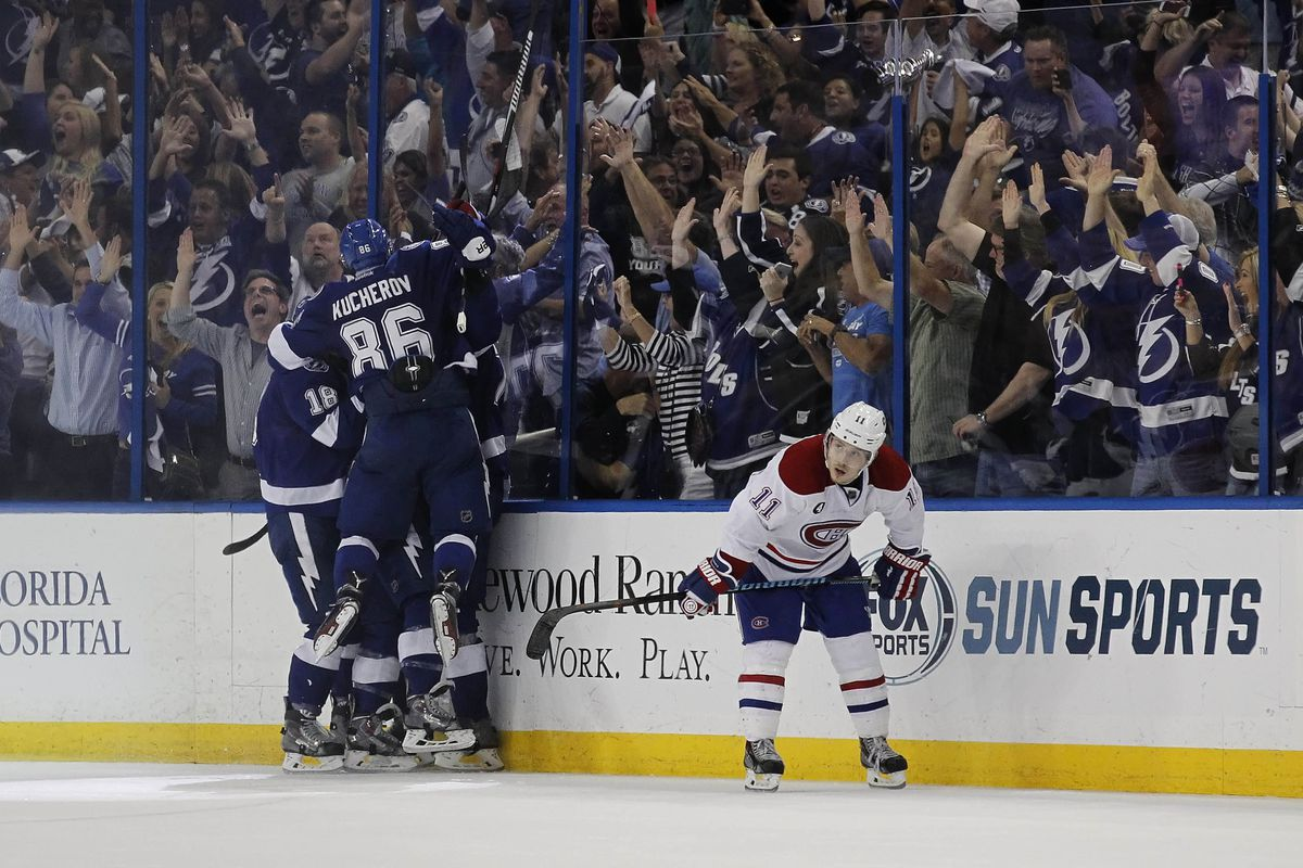 Tyler Johnson is mobbed by linemates Ondrej Palat and Nikita Kucherov after scoring the game winning goal with 1.1 seconds left in Tampa Bay's 2-1 win over the Montreal Canadiens Wednesday night in Tampa