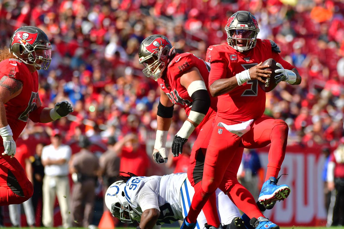 Jameis Winston of the Tampa Bay Buccaneers scrambles to throw a pass during the second quarter of a football game against the Indianapolis Colts at Raymond James Stadium on December 08, 2019 in Tampa, Florida.