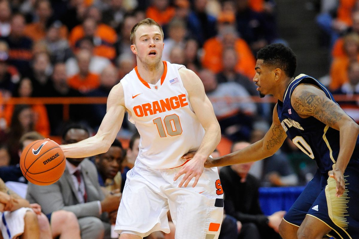 Eric Atkins doing what he can to contain the hot hand of Trevor Cooney