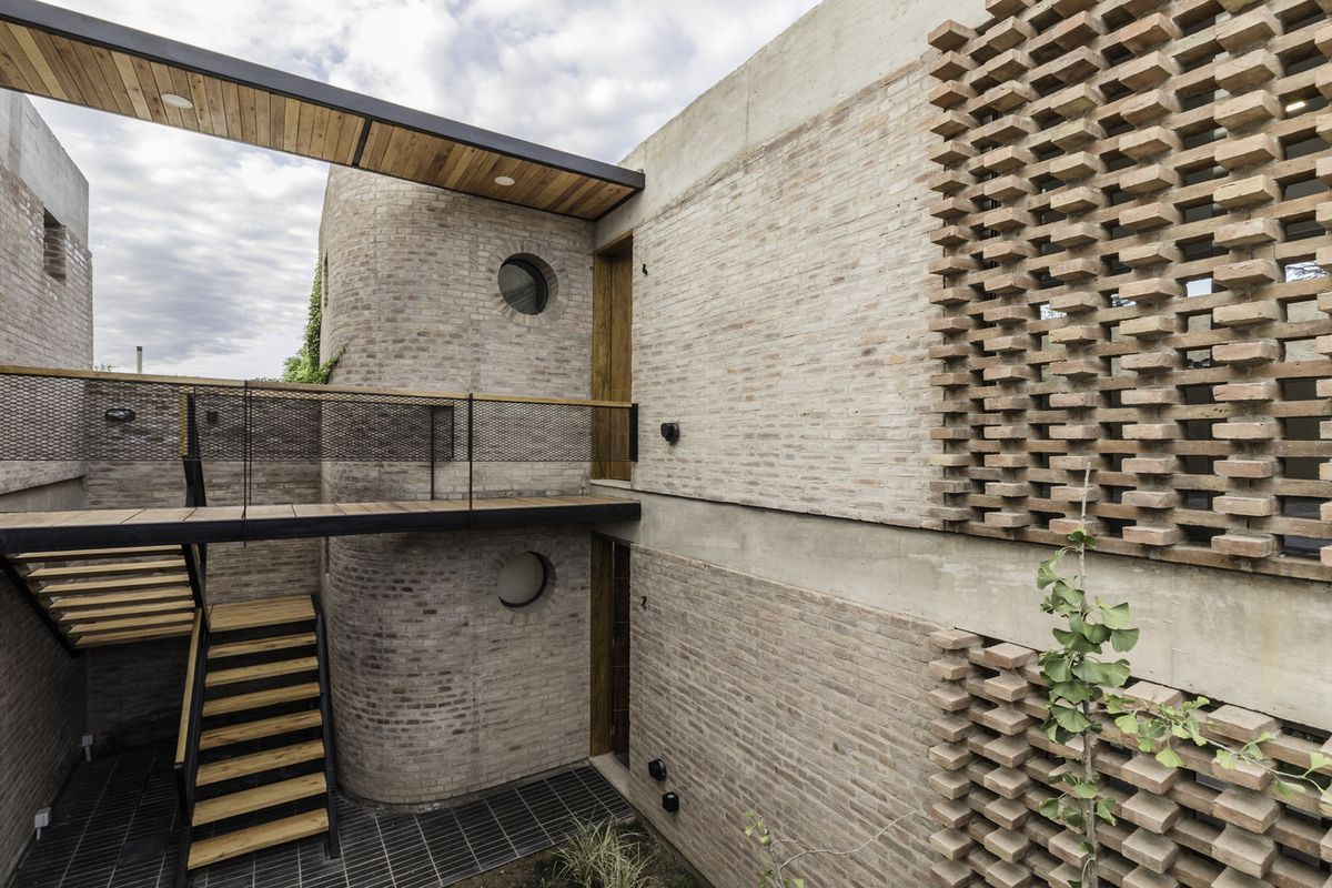 Brick exterior with porthole windows.