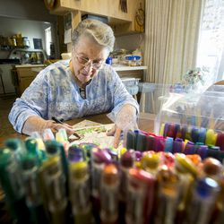 Betty Newbold sits at her kitchen table and colors as she talks about growing old and her feelings on being alone on Wednesday, Feb. 22, 2017.