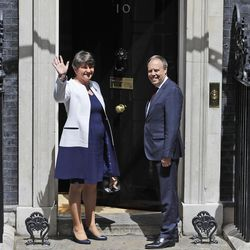 Leader of Northern Ireland's Democratic Unionist Party (DUP) Arlene Foster and Deputy Leader Nigel Dodds arrive at 10 Downing Street in London, for a meeting with Britain's Prime Minister Theresa May, Tuesday June 13, 2017. The meeting is taking place to see if an alliance can be created to push through the Conservative Party's agenda after a disastrous snap election left her short of a majority in Parliament.