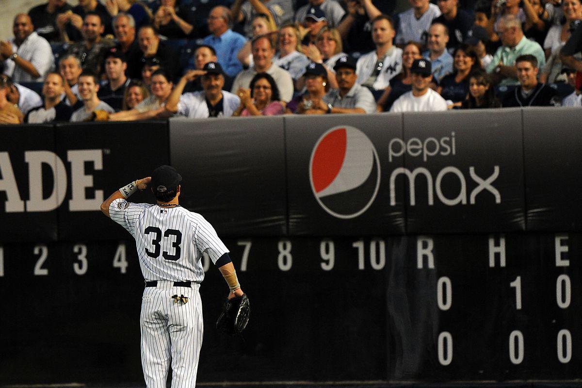 New York Yankees right fielder Nick Swisher #33 salutes the