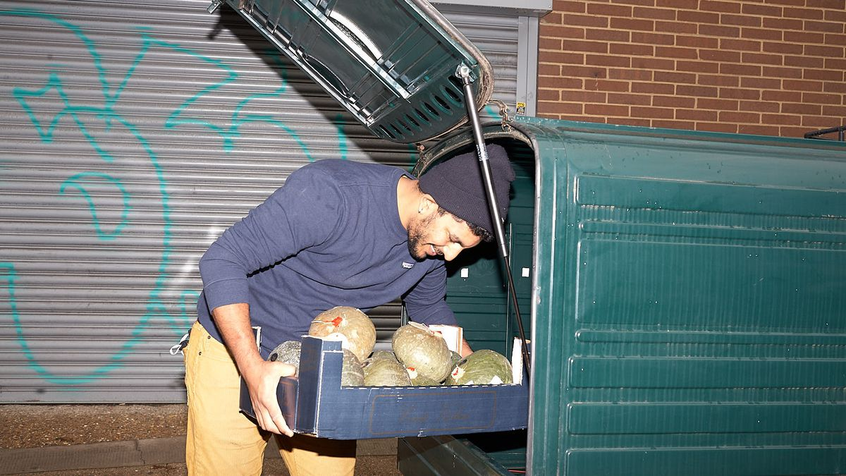 Ombra chef-owner Mitshel Ibrahim unloads a crate of Natoora's Delica pumpkins from a new Ape Piaggio the restaurant has bought to extend its local delivery radius