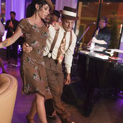 A couple dances to Lena Prima and her band as they play jazz, swing, and blues at the Hotel Monteleone Carousel Bar Saturday night.