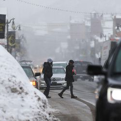 People cross Main Street in Park City as they attend Sundance on Sunday, Jan., 22, 2017.