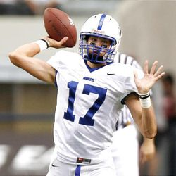 Bingham quarterback Ty Hannay throws a pass during the Miners' game against Euless (Texas) Trinity Monday at Dallas Cowboys Stadium in Arlington, Texas. Trinity won 42-21 in the Kirk Herbstreit Varsity Football Series.
