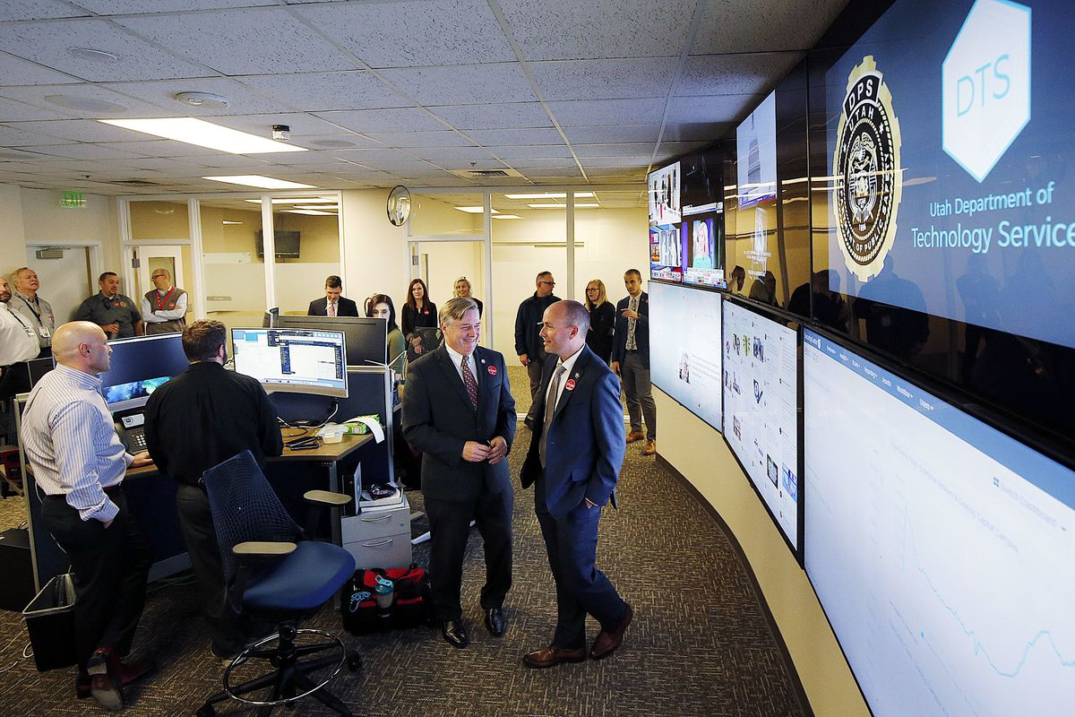 FILE - Mike Hussey, left, chief information officer and executive director of the Utah Department of Technology Services, shows Lt. Gov. Spencer Cox the Utah Cyber Center at the Capitol in Salt Lake City on election night, Tuesday, Nov. 6, 2018.