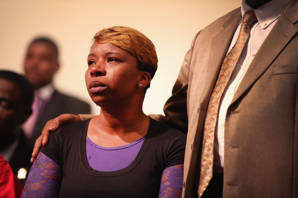 Tears roll down the cheek of Lesley McSpadden, the mother of slain teenager Michael Brown.